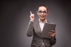 The young businesswoman working with tablet computer Royalty Free Stock Photos