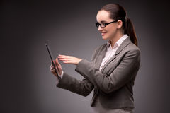 The young businesswoman working with tablet computer Stock Photography
