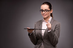 The young businesswoman working with tablet computer Stock Image