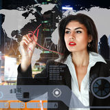 Young businesswoman working on touch screen Royalty Free Stock Images