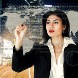 Young businesswoman working on touch screen Royalty Free Stock Photos