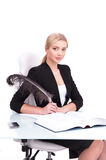 Young businesswoman working on white background and looking into camera. Stock Photography