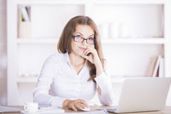 Young businesswoman at workplace Stock Photo