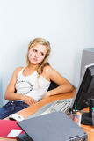 Young businesswoman works on a laptop computer in the modern off Stock Image