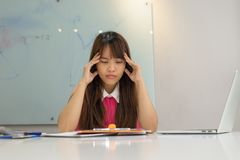 Young businesswoman worry about the big problem Stock Images