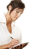 Young businesswoman write. Stock Photo