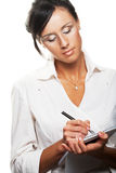 Young businesswoman write. Royalty Free Stock Photos