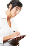 Young businesswoman write. Royalty Free Stock Images