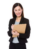 Young businesswoman write on clipboard Stock Images