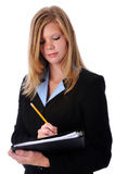 Young businesswoman writing Royalty Free Stock Photo
