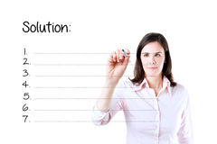 Young businesswoman writing blank solution list. Stock Photography