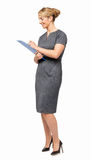 Young Businesswoman Writing On Clipboard Stock Photo
