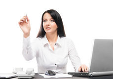 Young businesswoman writing on a display in an office Royalty Free Stock Photos