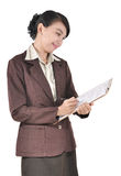 Young businesswoman writing on a folder Stock Images