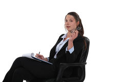 Young businesswoman writing Royalty Free Stock Photography
