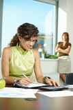 Young businesswoman writing notes Royalty Free Stock Photography