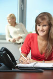 Young businesswoman writing notes Royalty Free Stock Images