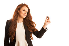 Young businesswoman writing on transparent board against white b Royalty Free Stock Photos