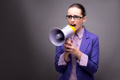 The young businesswoman yelling through loudspeaker Stock Photo