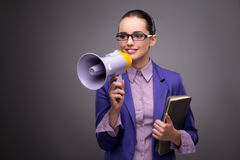 The young businesswoman yelling through loudspeaker Stock Photography