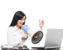 Young businesswoman yelling with a megaphone Royalty Free Stock Photo