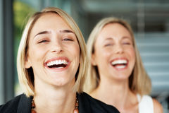 Young businesswomans laughing Stock Photos