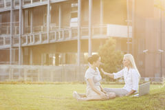 Young businesswomen discussing in office lawn royalty free stock image
