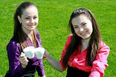 Young businesswomen drinking tea and talking Stock Image