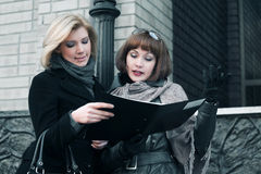 Young businesswomen with financial reports Stock Photography