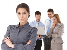 Young businesswomen in front of team Stock Photo