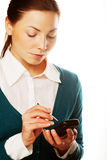 Young businesswomen with PDA Royalty Free Stock Photo