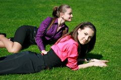 Young businesswomen relaxing on the grass Stock Images