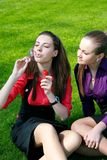 Young businesswomen relaxing on the grass Royalty Free Stock Image