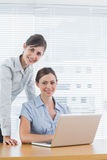 Young businesswomen smiling at the camera Royalty Free Stock Photos