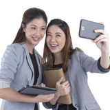 Young businesswomen taking self portrait Stock Photography