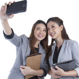 Young businesswomen taking self portrait Stock Photo