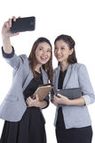 Young businesswomen taking self portrait Royalty Free Stock Image