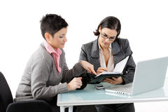 Young businesswomen talking stock images