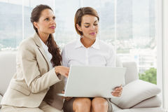 Young businesswomen using laptop Royalty Free Stock Photography