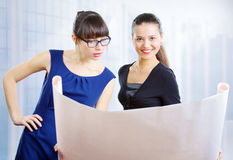 Young Businesswomen Watching A Drawing Royalty Free Stock Images