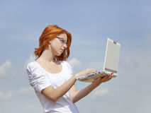 Young Businesswomen in white keeping laptop Stock Images