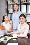 Young businesswomen working with laptop and digital tablet at workplace. Smiling young businesswomen working with laptop and digital tablet at workplace Stock Photography