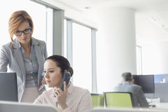 Young businesswomen working in office Stock Photography