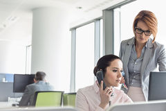 Young businesswomen working in office Stock Images