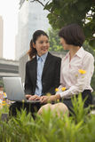 Young businesswomen working outdoors Stock Images