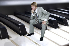 Young bussinesman. On piano Royalty Free Stock Image