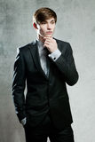Young bussinesman in gray suit thinking or dreaming Royalty Free Stock Images