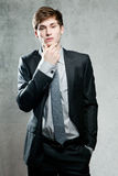 Young bussinesman in gray suit thinking or dreaming Stock Photography