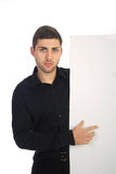 Young bussinesman pointing. White card royalty free stock photo