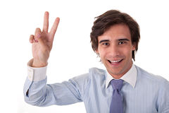 Young bussiness man with arm raised in victory sig Stock Photos